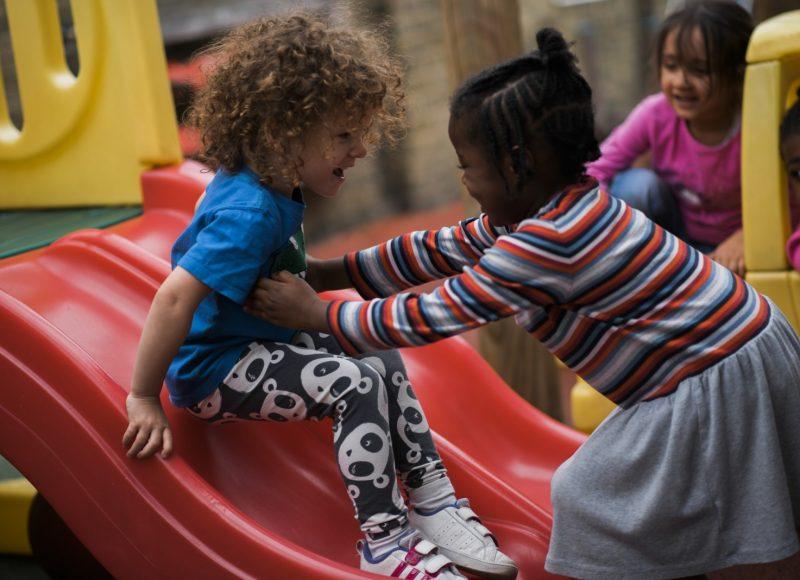 Playing on the slide at Rainbow Nursery