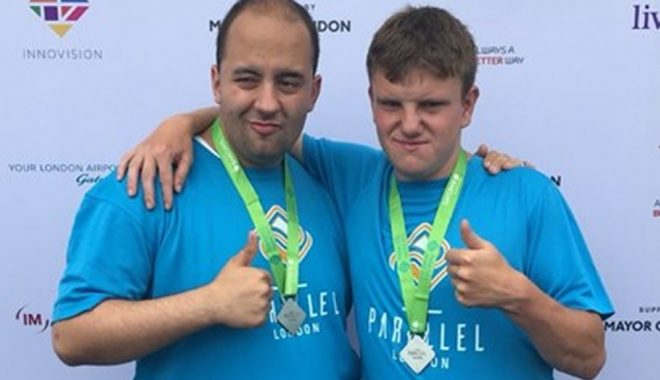 Ben and Aran with their medals