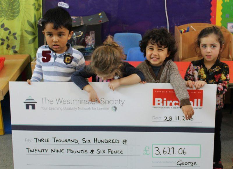 Children from Rainbow receiving cheque from George Birchall Ltd