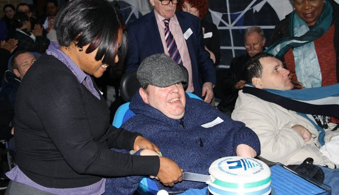 Royston cutting the cake for the 40th Anniversary of Alison House